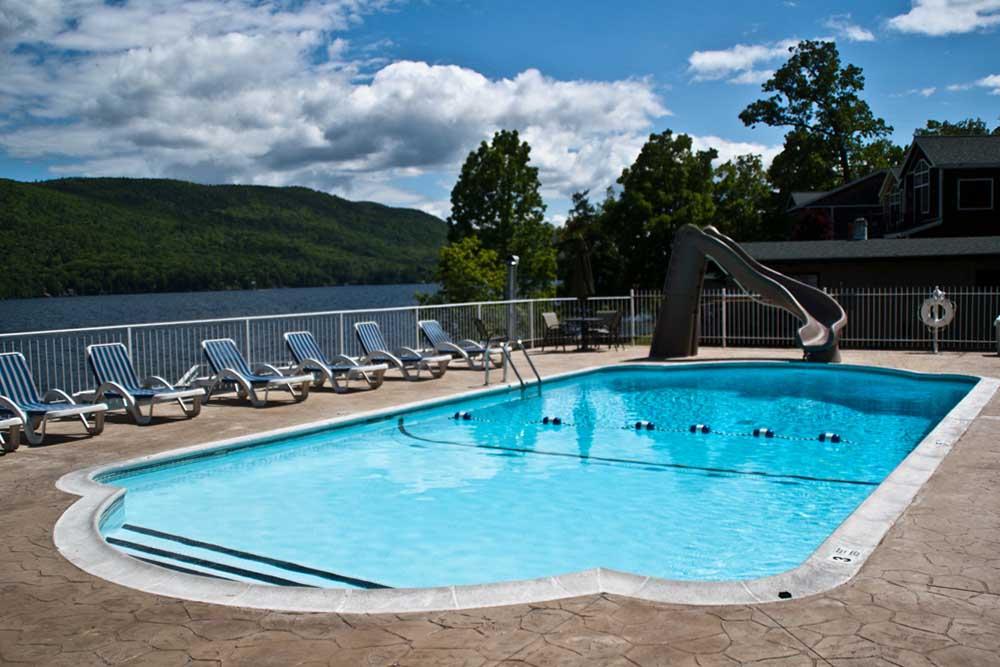 Pool with slide overlooking lake