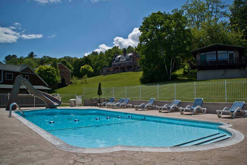 Pool and large lawn on hill