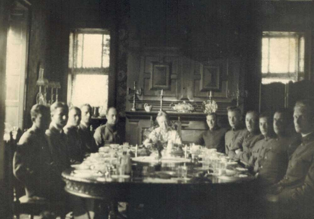 Group photo of family sitting around table