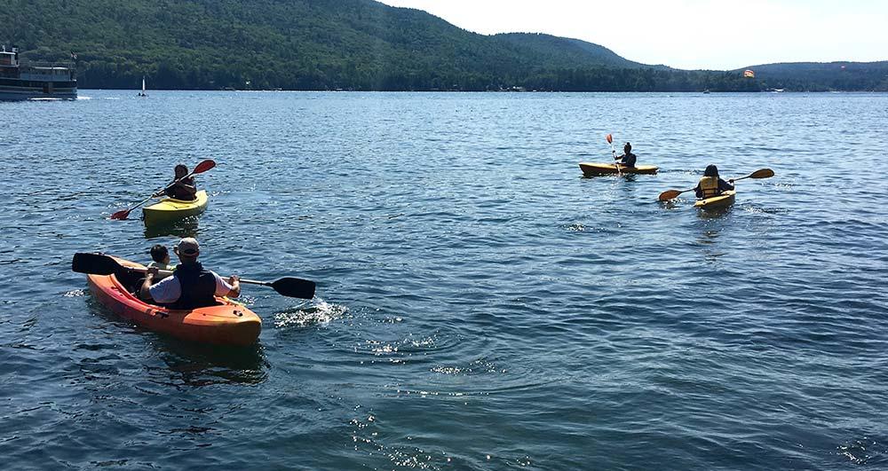 Group kayaking on lake