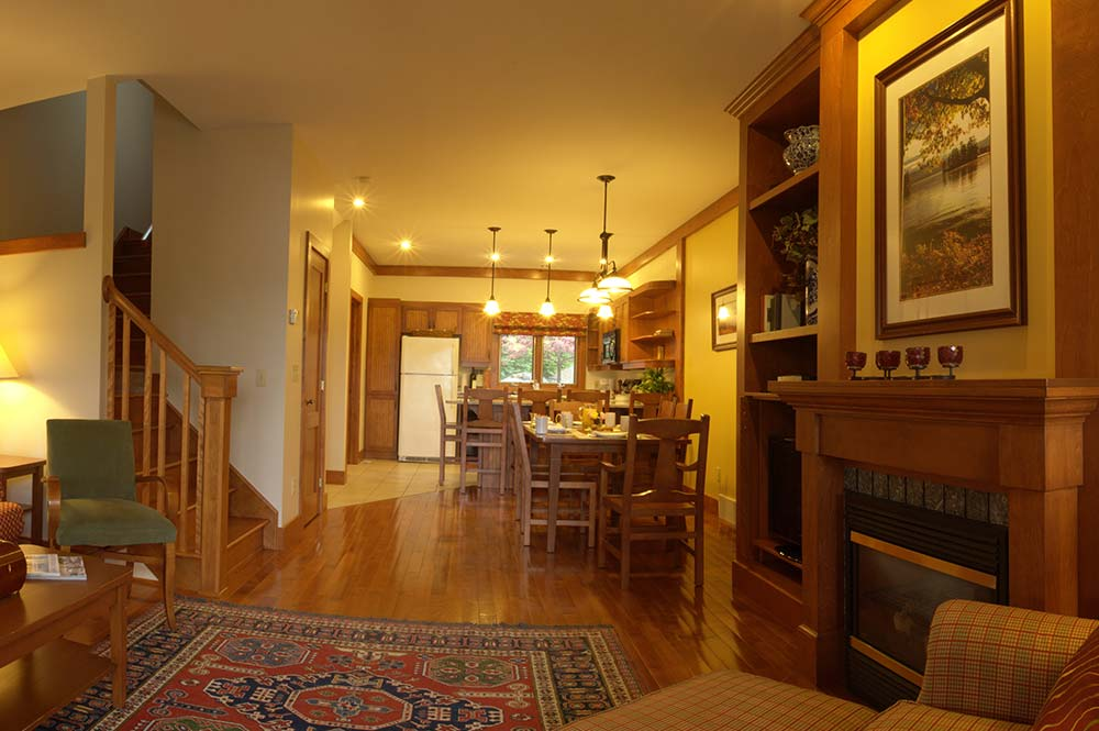 Living room with fireplace, dining area and kitchen