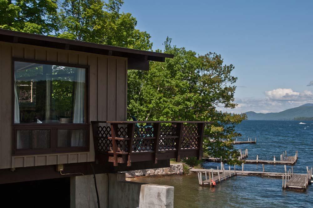 deck overlooking lake with docks