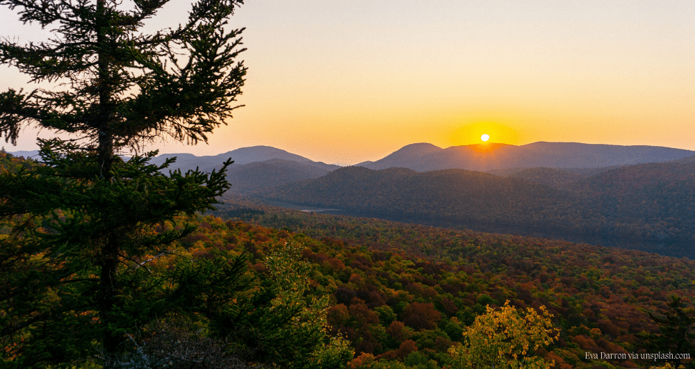 The sun setting over the Balm of Gilead Mountains in Johnsburg, NY in the fall